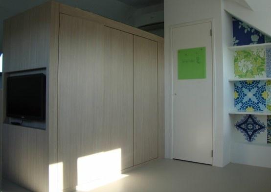WiggersDesign | Open zolder - twee kamers gescheiden door kastenwand