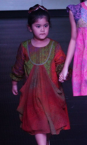Almira Tunggadewi, grandson of the first President of Indonesia Susilo Bambang Yudhoyono in a batik dress