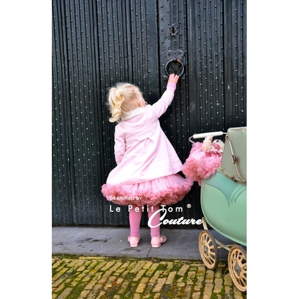 Cute little DOLLY girl in Isabella pink DOLLY skirt
