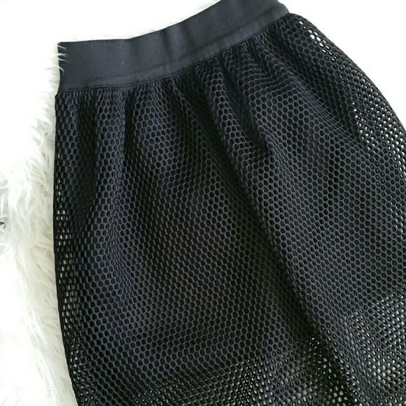 Black Mesh Skirt Black Mesh skirt. Solid skirt underneath. Never worn. But opening has seams coming undone a bit, but can easily be fixed with a sew! Skirts Midi