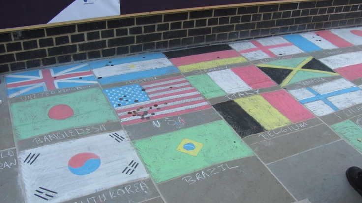 Street Design: Flags of various countries drawn in chalk in front of The Globe theatre in London.