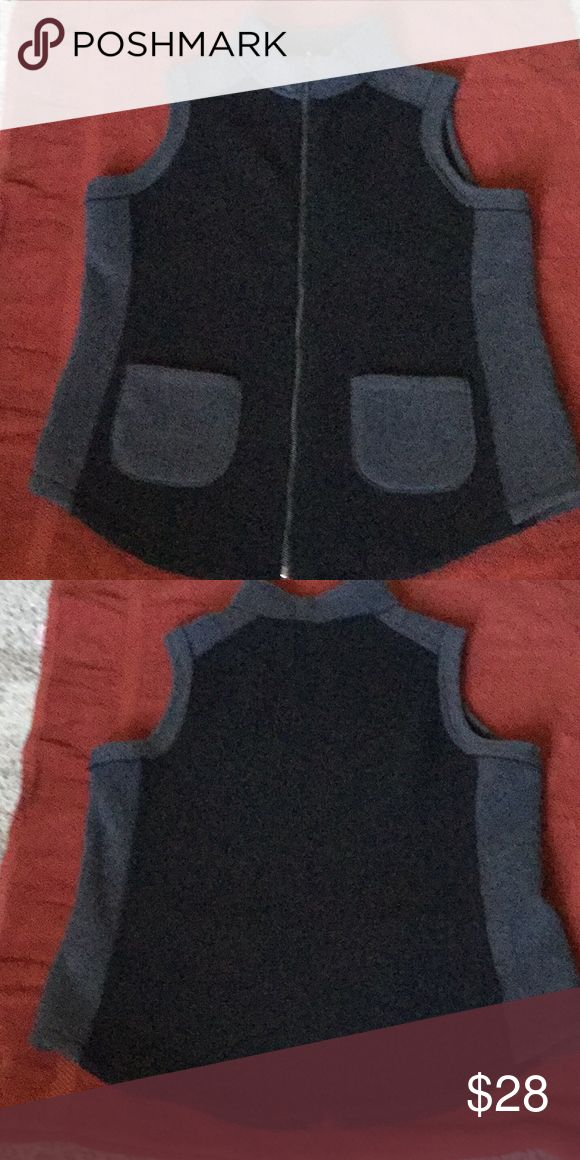 """Polar fleece vest * Fabrication: bonded polar fleece * Hardware: zip-front closure * Features: color blocked, mandarin collar, sleeveless, two front hip patch pockets, shirttail hem  * Fit: semi-fitted; follows the lines of the body with added wearing ease * Content: shell/lining 100% polyester * Care: machine wash, tumble dry Chest 43-1/2"""" length 27-1/2"""" from a smoke free home Susan Graver Jackets & Coats Vests"""