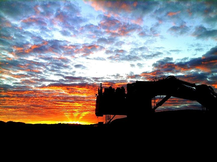 Liebherr - A really beautiful sunrise in an iron ore mine in Western #Australia - witnessed by a Liebherr mining #excavator, type R 996 B!