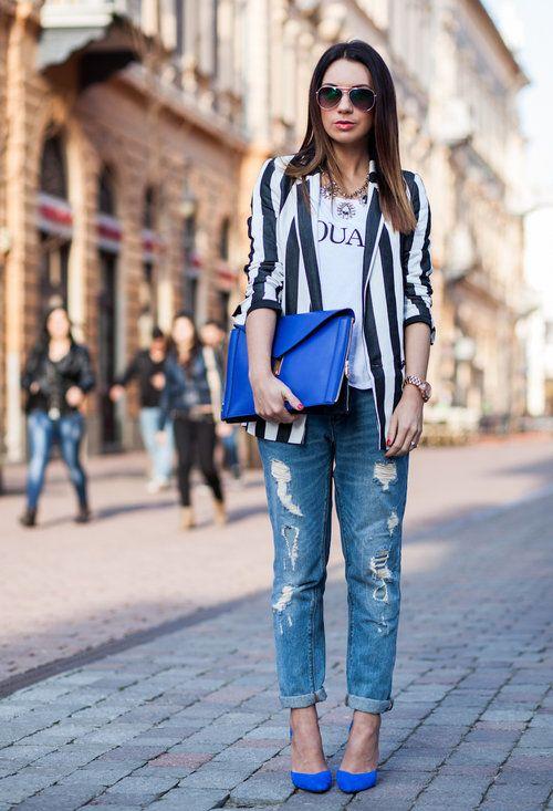 Striped blazer, screen tee, statement necklace, distressed