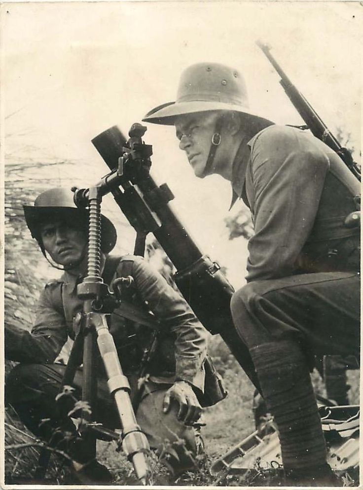 1945- Soldiers of the Royal Netherlands Indies Army manning a Stokes mortar at Tarakan, Borneo.