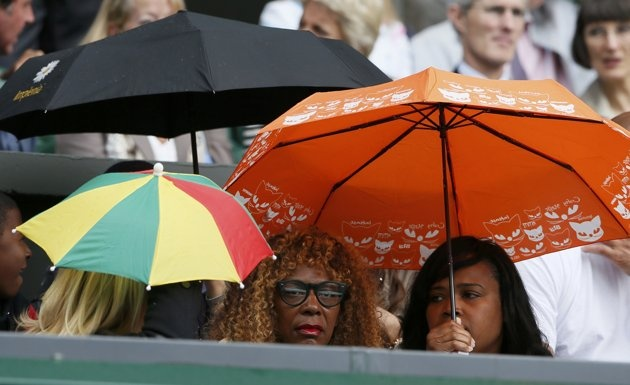 Oracene Williams (C), the mother of Serena Williams of the U.S., sits on Centre Court for the women's final tennis match between Williams and  Agnieszka Radwanska of Poland at the Wimbledon tennis championships in London July 7, 2012.