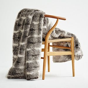 A stunning faux fur in shades of grey, brown and white that will make a luxurious decorating statement for living or bedroom areas.