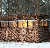 Modern Log Cabin   Commissioned by the entertainer Hans Liberg and designed by Piet Hein Eek, this music studio has a hide-and-seek exterior and bright work-all-day interior.    Read more: Prefab Contemporary Log Studio | Inhabitat - Sustainable Design Innovation, Eco Architecture, Green Building
