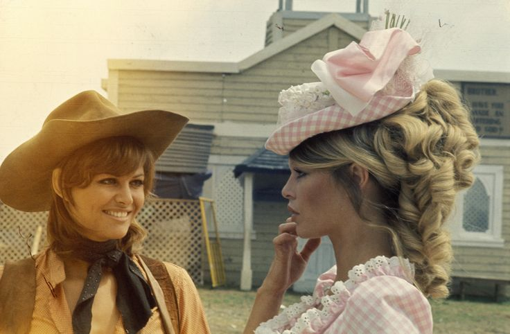 Claudia Cardinale and Brigitte Bardot on the set of Les pétroleuses directed by Christian-Jaque, 1971. Photo by Gianni Ferrari
