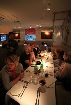 Diners at Fellinis Restaurant - vegetarian resto in lake district, England