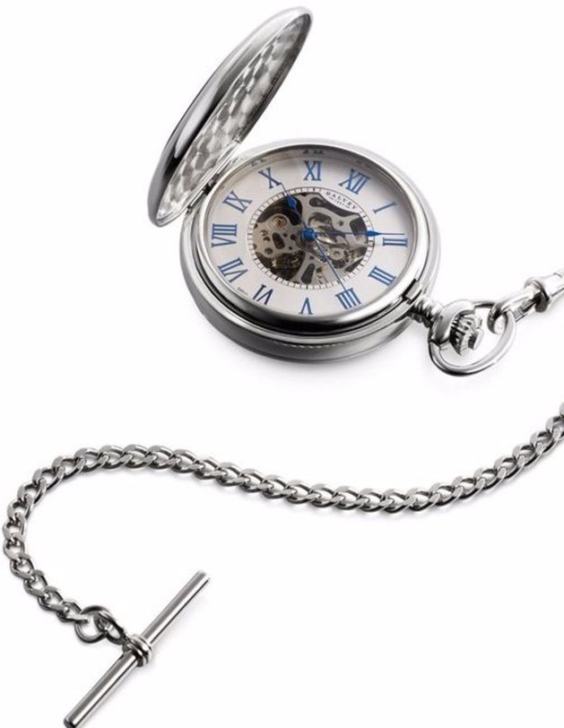 The intricacy of the mechanical movement of this Dalvey pocket watch is visible through the window on the fob case and the exposed section of the meticulously finished watch face.