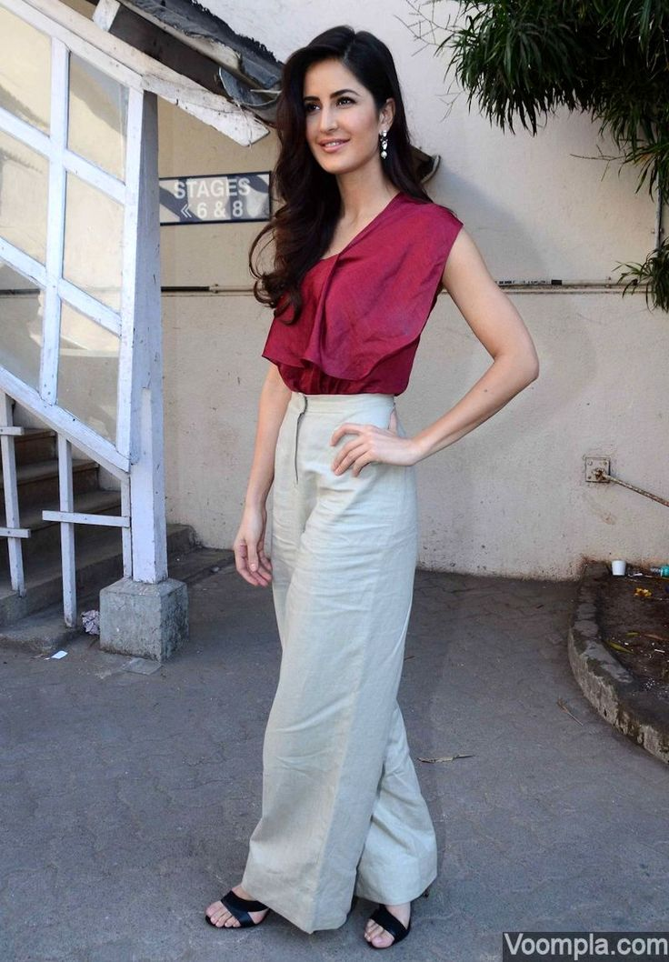 Fashionista Katrina Kaif wearing a Lola by Suman B outfit made up of a deep crimson silk top and linen wide-leg palazzo style pants. via Voompla.com