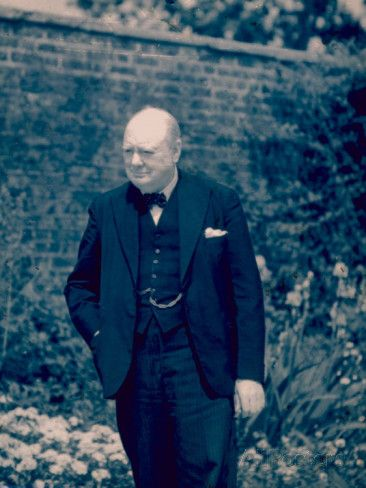 English Prime Minister Winston Churchill Standing Alone in a Garden During WWII Premium Photographic Print