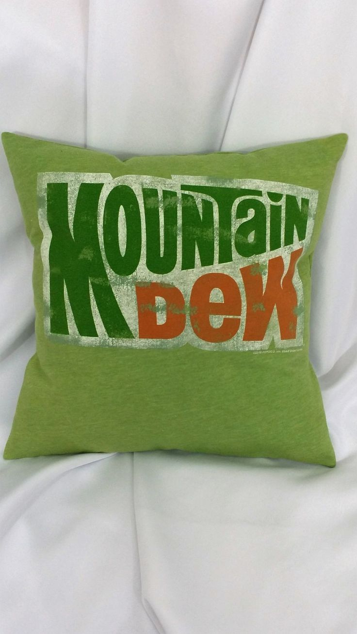 Now, I just need to find a Doritos pillow cover. This novelty bedding is made from a Mountain Dew tshirt. It features a distressed Mountain Dew logo on a matching light green background. This listing