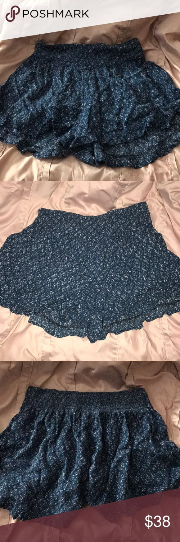 Adorable American Eagle Flowy Shorts! these shorts and so comfortable and even makes you look a little dressed up! They have an elastic band so they are stretchy! Also they are so flowy they can pass as a skirt while you are perfectly comfortable! they are in amazing condition!:) American Eagle Outfitters Shorts
