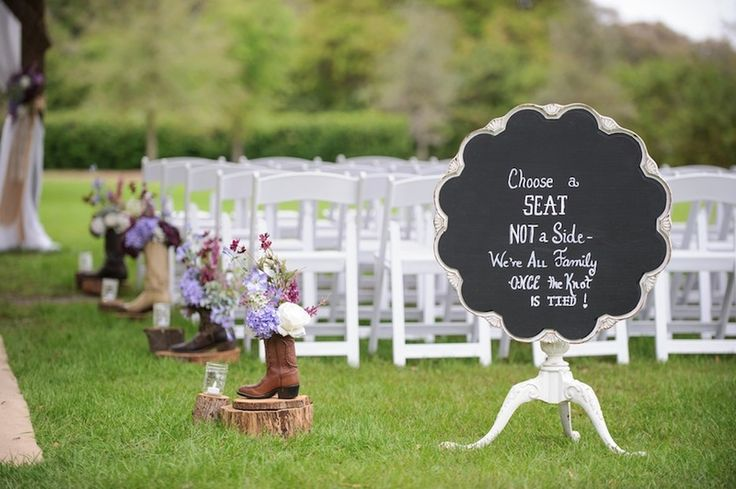 Cowboy Boot Wedding Ceremony Decor with Purple Flowers and Chalkboard Sign | Tampa Bay Cross Creek Ranch Wedding