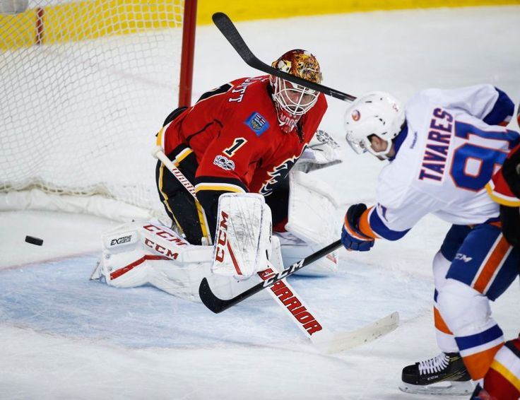 Islanders vs. Flames:     March 5, 2017  -   The Islanders fell to the Calgary Flames, 5-2, on Sunday at the Scotiabank Saddledome.   -      New York Islanders' John Tavares, right, scores on Calgary Flames goalie Brian Elliott during second period NHL hockey action in Calgary, Alberta, Sunday, March 5, 2017.