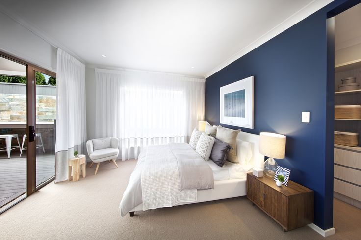 Clarendon Homes. Brighton 30. Master bedroom with navy blue feature wall.