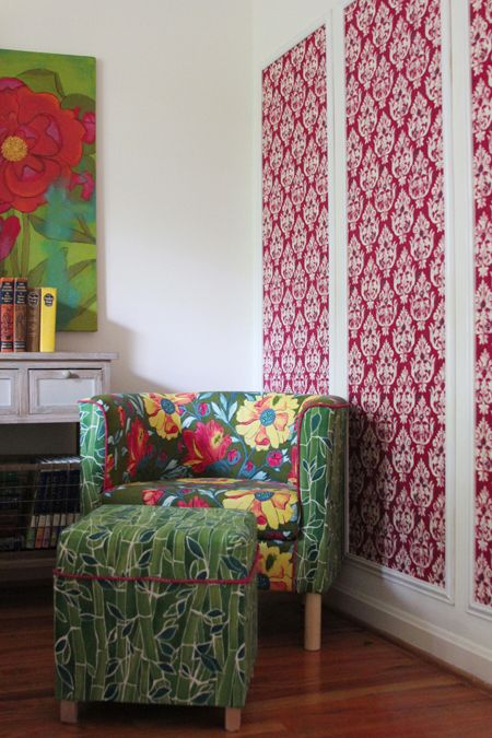 Staple fabric directly to wall, add molding around. (Perfect solution, Laura Gunn!)