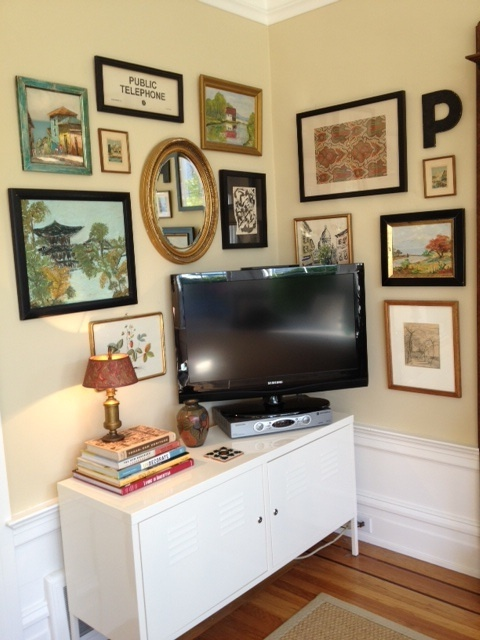 With out the TV I like the look of these picture frames and a dresser or self