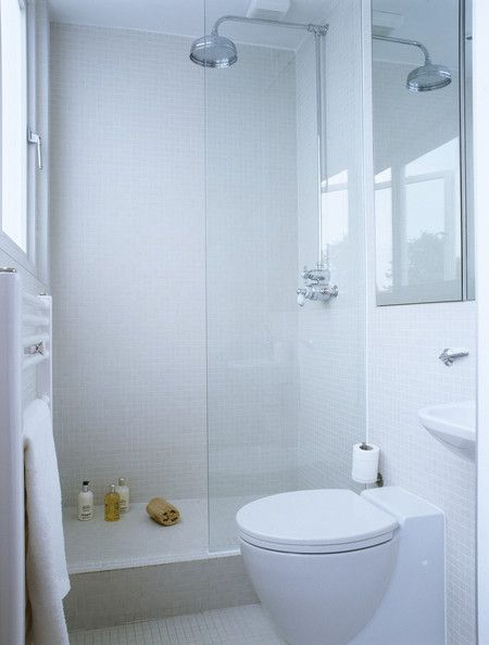 simple small white bathroom walk in glass shower