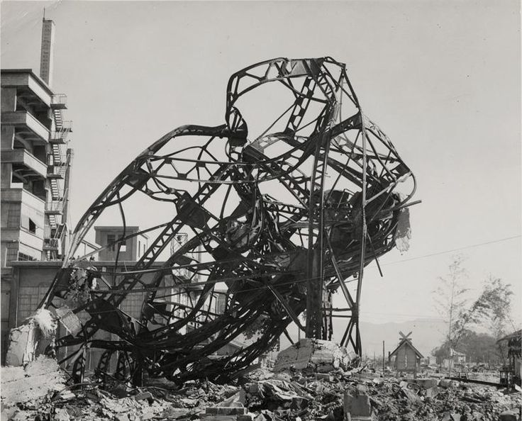 HIROSHIMA, late 1945—The twisted wreckage of a theatre lurches above rubble some 900 yards from the epicenter of the explosion. The bomb dropped on Hiroshima killed about 70,000 people immediately; another 70,000 were injured, and thousands more have since died as a result of radiation exposure. PHOTOGRAPH BY BERNARD HOFFMAN, THE LIFE PICTURE COLLECTION, GETTY IMAGES