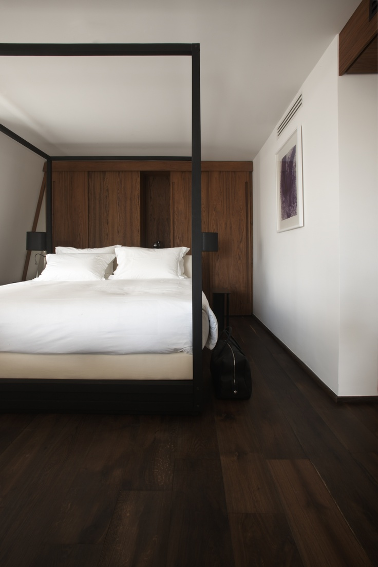 François Champsaur Hotels. This bed reminds me of: http://www.naturalbedcompany.co.uk/shop/four-poster-bed/zebrano-cube-4-poster-bed/