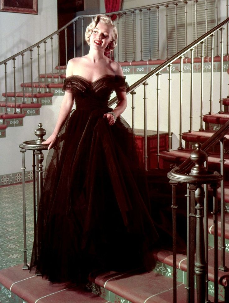 Oscars 1951 - Marilyn Monroe, presenter at the 23rd Academy Awards wore a black tulle from the 20th Century Fox wardrobe department.  She accessorized with a pair of simple diamond drop earrings, and a wide Art Deco diamond bracelet.