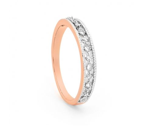 This delicate rose gold and diamond band has an intricate open pattern with milgrain rails to give it a vintage look