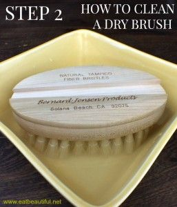 Remove the handle from your dry brush. Place the brush into the water solution, bristles facing down, agitating the water gently (with a back and forth or swishing motion), moving the brush around in the sanitizing water, both freeing dead skin cells and distributing the essential oil amidst the bristles. (Essential oils don't mix evenly into water.)