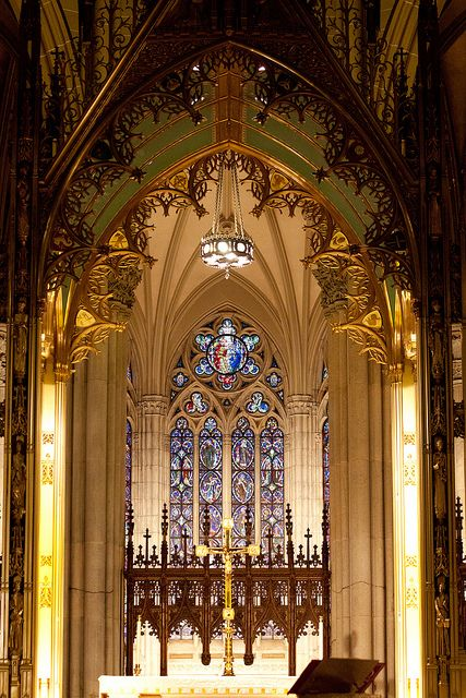 The amazing interior of St. Patrick's Cathedral, New York City. St. Patrick's is  located on the east side of Fifth Avenue between 50th and 51st Streets in midtown Manhattan, directly across the street from Rockefeller Center and specifically facing the Atlas statue. (V)