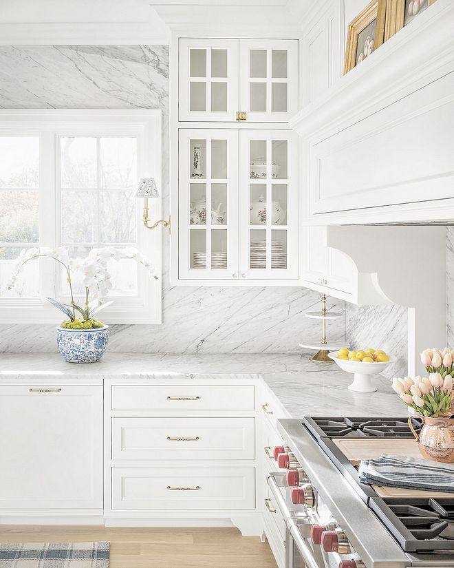 Benjamin Moore Oc 117 Simply White Kitchen With White Carrara Marble Slab Backsplash Whit White Kitchen Design Marble Countertops Kitchen Classic White Kitchen