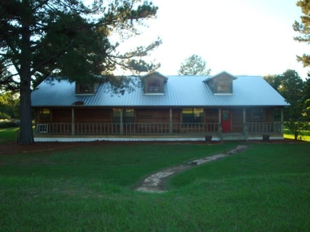 Metal roof on ranch houses 20 cr 1122 maud tx ranch for Ranch style metal homes
