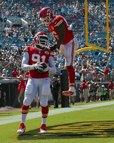 Tamba Hali #91 of the Kansas City Chiefs celebrates a touchdown during a game against the Jacksonville Jaguars at EverBank Field on Septembe...