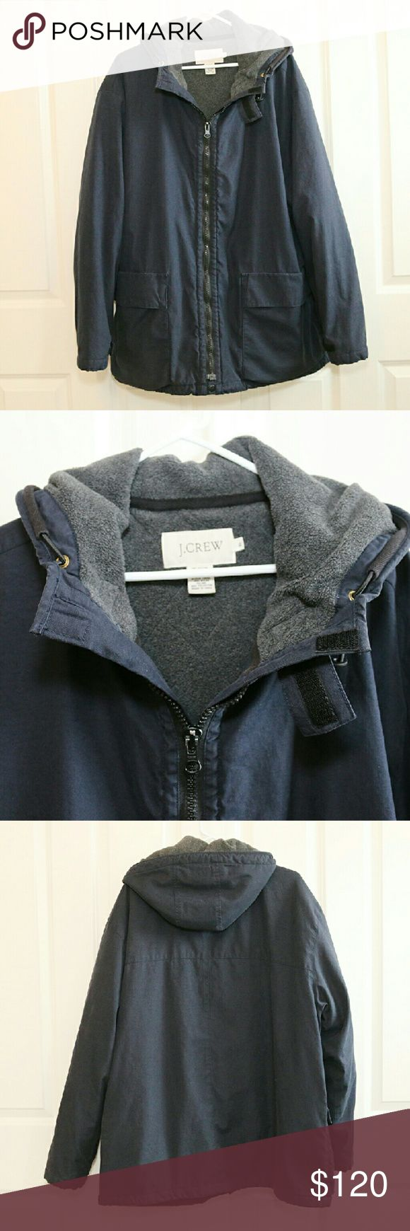 J.Crew Men's Parka Jacket Navy Blue XL J.Crew Men's Parka Jacket.  Size XL.  Navy blue outside, charcoal grey inside.  Hooded.  Excellent used condition.  No rips, stains.  Inside pen pocket.  Two large pockets in front.  Fleece lined.  Only thing that looks to be missing is the cinch cords at the bottom of jacket.  About 27 inches armpit to armpit.  About 32 inches shoulder to hem.  Retails around $350.00.  ** Only reasonable offers will be considered. J. Crew Jackets & Coats