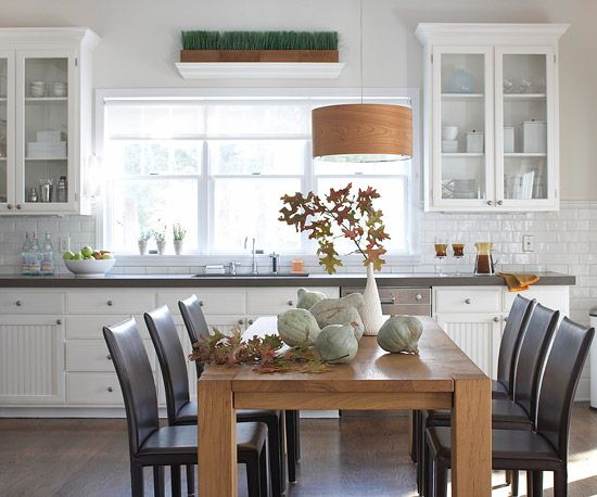 Small gourds and a leafy centerpiece give this kitchen subtle fall style