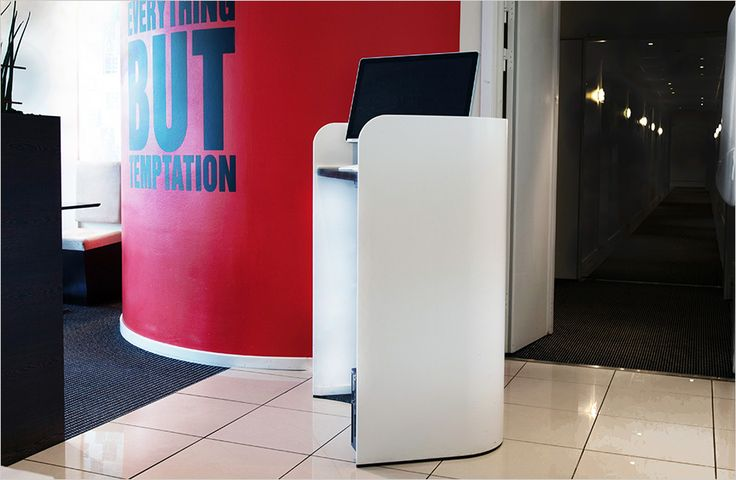 Impact lectern, rostrum and podium in massive glacier white Corian®, linoleum table top and acoustic felt at the inside. Talerstol og pult i massivt Corian®, linoleum plade og akustisk filt på indersiden.