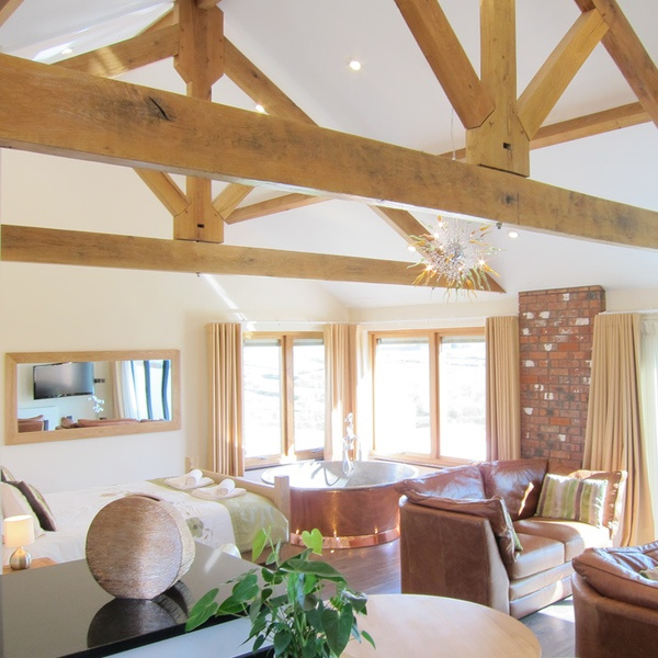 Wedding Suppliers | Wooldown Holiday Cottages | confetti.co.uk | Beautiful old wooden beams across the room