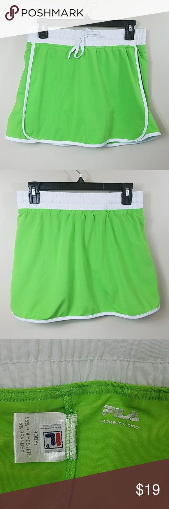 "Fila Neon Green & White Skort Fila Neon Green & White Skort.   Size small.  Drawstring waist, white piping detail, matching green shorts underneath.  13.5"" across the waist.  13"" long. 95% polyester,  5% spandex. Fila Shorts Skorts"