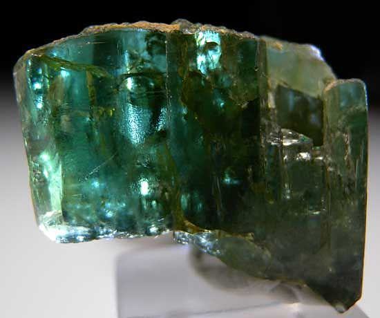 """A866 - Zoisite $ 1400 Alchuri, Skardu District, Pakistan thumbnail - 2.6 x 2 x 1.1 cm -  Green """"Tanzanite"""" from Pakistan has always been intriguing to me as only the second locality I'm aware of that produces gem quality Zoisite. Production has always been very sporadic and nothing has been turning up for years. I bought this about 15 years ago and it has been in my collection ever since. The left side of the crystal has some gemmy zones with great green coloration. Complete all around."""