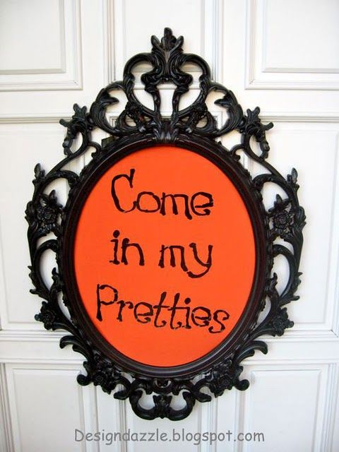 And your little dog too. (similar frame at Ikea for 35 $ large with mirror)......dress like a witch and hang this on my classroom door