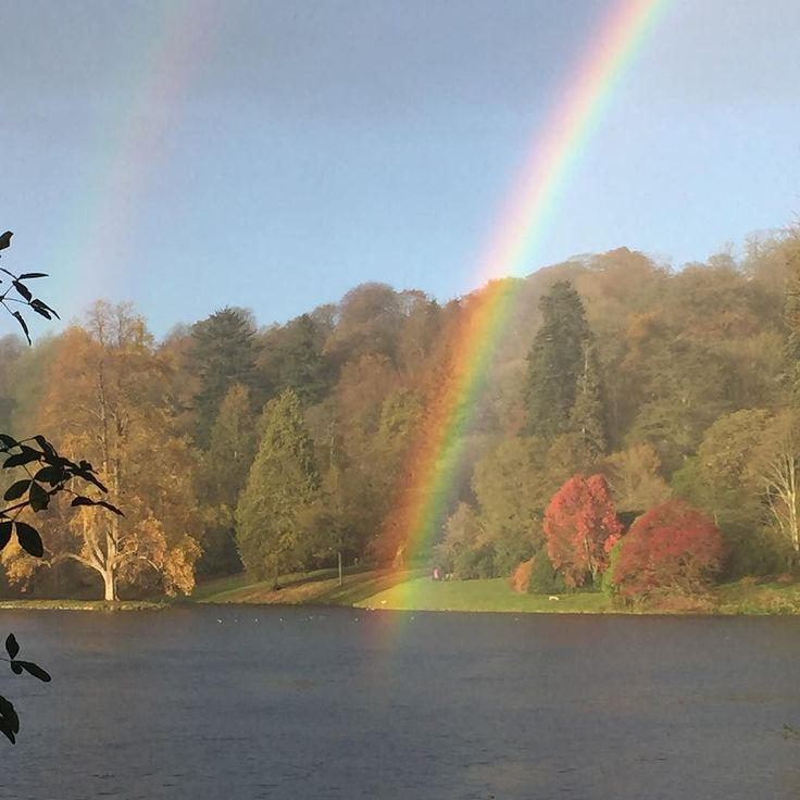 The most PERFECT  at @ntstourhead today - reaching into the lake. The pot of gold must be at the bottom.  #stourhead #nationaltrust #doublerainbow