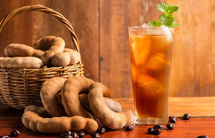 Tamarind juice is a rich source of antioxidants and offer many benefits for your hair & health. Read on 17 top tamarind juice benefits in this article below