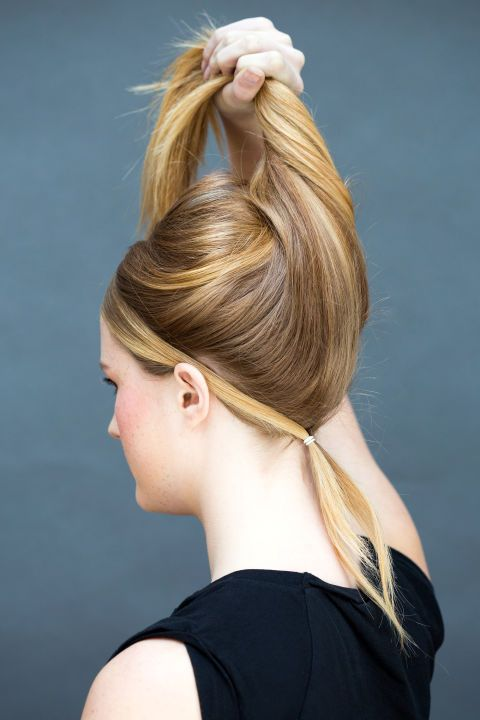 Secure those face-framing pieces with an elastic band at the nape of your neck, and take your pony down so your hair falls loosely over it.