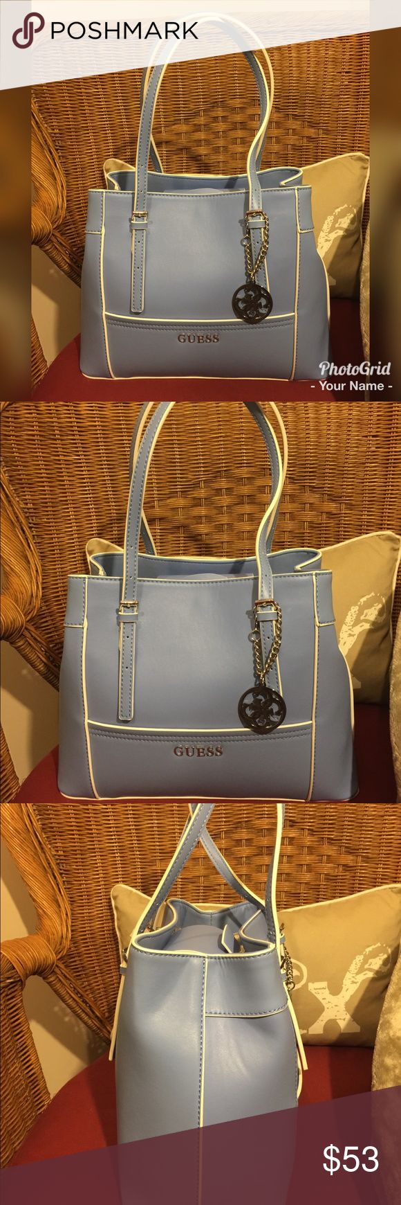 "Guess Powder Blue Handbag 👜 This baby blue handbag has white piping and is just adorable! It is new and never been used and still has its original packaging inside. It's dimensions are 13"" width by 10"" height by 7"" depth. This is a real deal! Currently selling on Amazon for $98!! Guess Bags Totes"