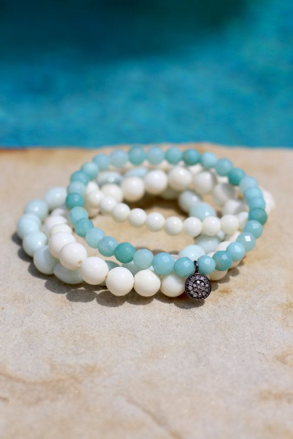Beautiful sea-foam aqua blue amazonite beads are highlighted with a genuine pave diamond disc on this happy stretch bracelet. It pairs perfectly with all things beachy! I rarely find amazonite as pretty - these 6mm beads are some Ive had hidden away for a long time. The 8mm round pave diamond disc charm (on sterling silver) is a perfect focal point for them. Youll definitely want to pack this one for your summer vacation. ;)) **This listing is for ONLY the 6mm faceted amazonite stretch…