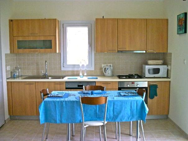 To the left of the living room is the open plan kitchen. You will find all necessary utensiles, hob, oven, freezer, fridge, microwave, dish washer, washing machine, iron board! The diner table can be extended to fit 6 people