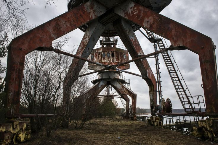 The explosion of the Chernobyl nuclear power plant blanketed a vast swath of the western Soviet Union with radioactive fallout. Thirty years later, 1,600 square miles of northern Ukraine and southern Belarus remains a wasteland except for the hardiest wildlife, a small holdout of elderly citizens, and industrial workers, some who roam the countryside scavenging radioactive metal. They dismantle the abandoned equipment, railroads and buildings that still stand, sandblasting away any…