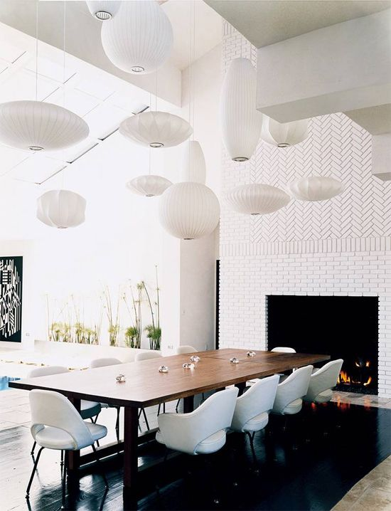 ... herringbone chevron pattern, modern dining table, modern white pid  dining chairs, glossy ebony wood floor and George Nelson bubble pendants  chandeliers.
