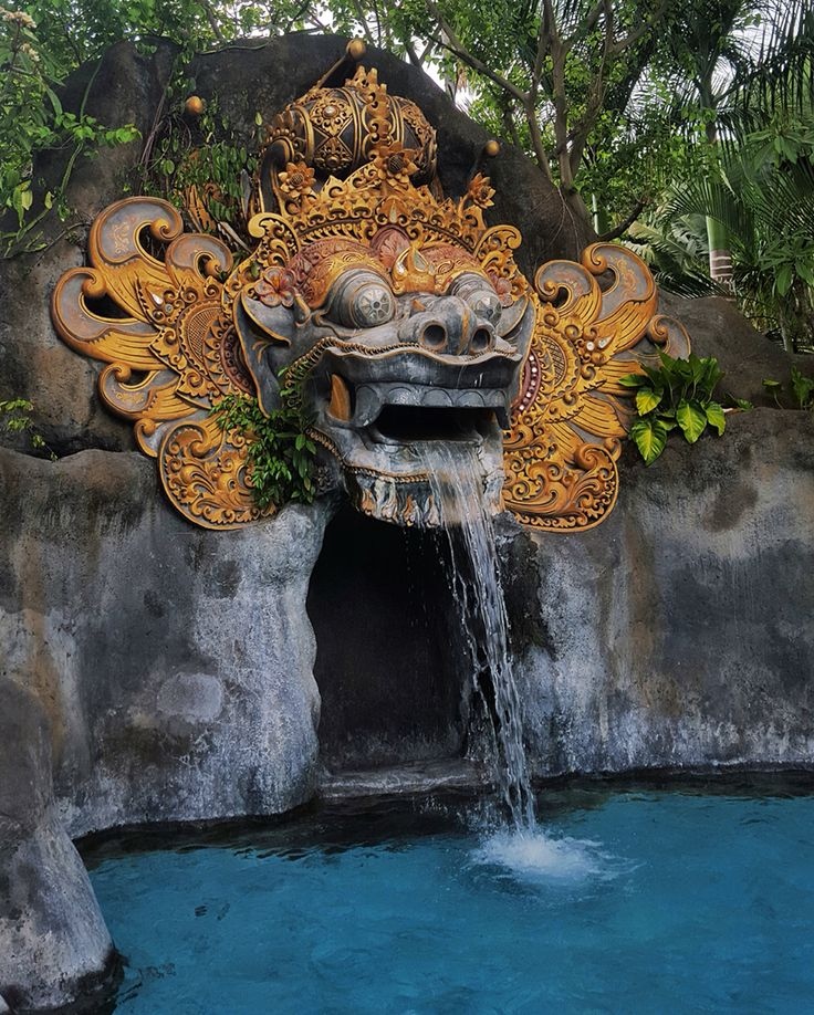 This elaborate and over-scaled 'Barong' Mask, a lion-like creature featured deep within the Balinese culture, is a focal point of the large new swimming pool that connects with all the ground floor guest rooms at the Padma Resort in Legian, Bali. By #MilesHumphreysArchitect